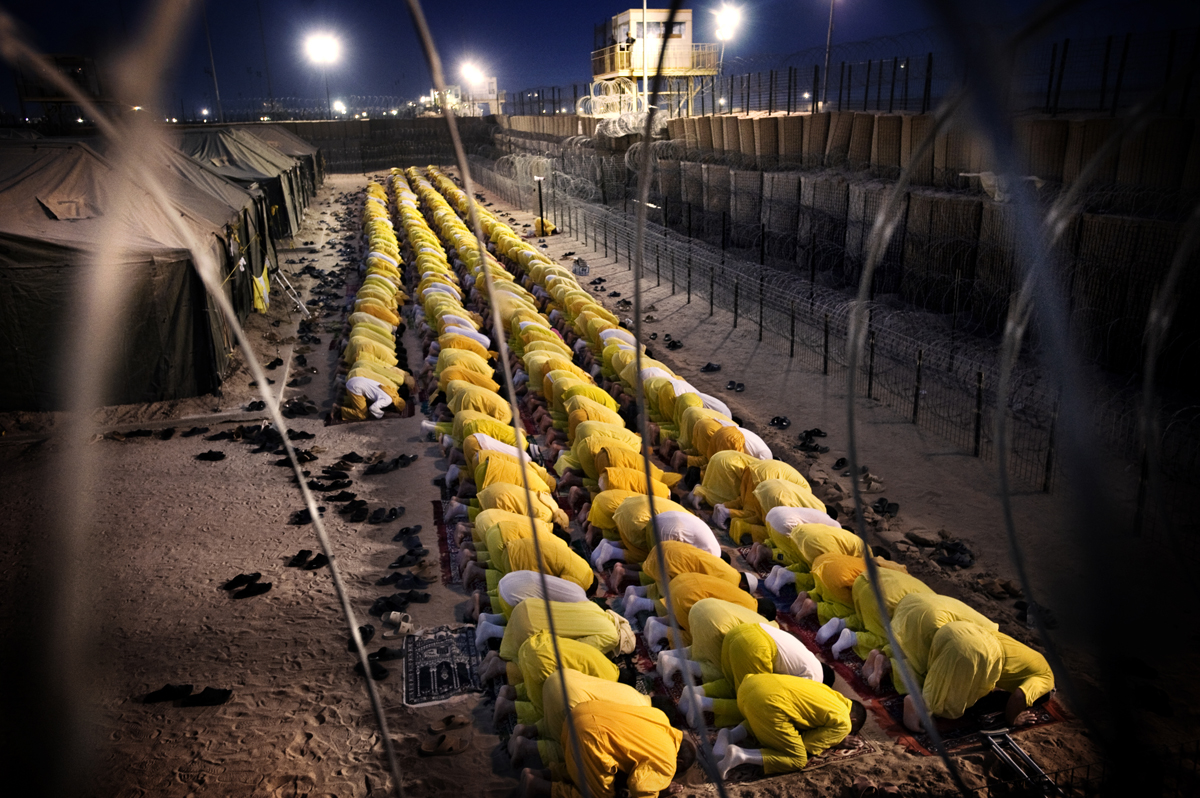 a U.S. military detention facility Camp BuccaDetainees pray at a